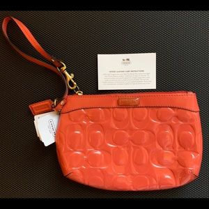 NWT Coach Patent Leather Embossed Wristlet